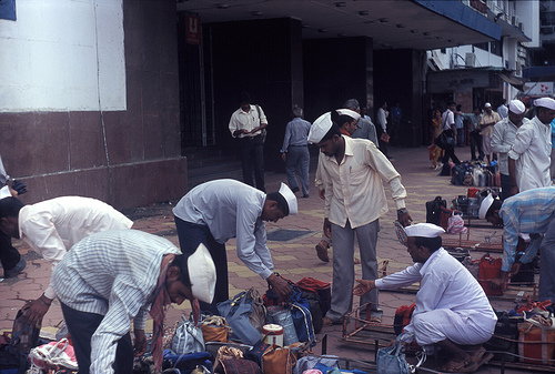 Indian dabbawalas delivering